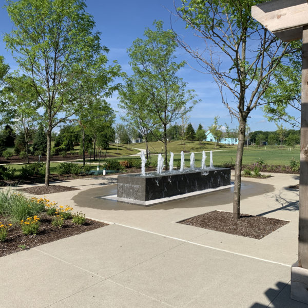 Fischer Design designed the amenity areas for the Serenade development that included entrance monuments, pigeonnier, open lawn, event space, playground, extensive landscaping, fire pits and water features.
